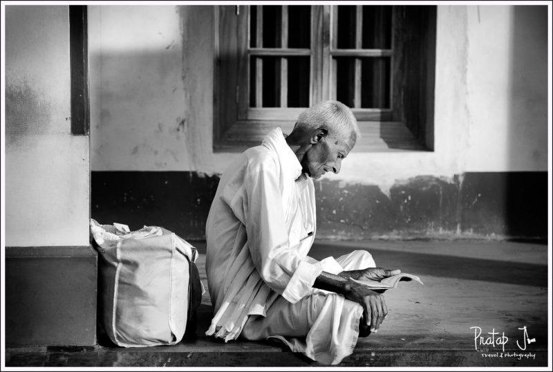 An Old Man Reads a Panchanga