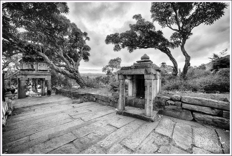 Climbing the Yoganarasimha Temple at Melkote