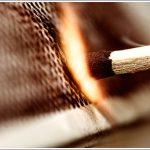 Close up a matchstick with a spark