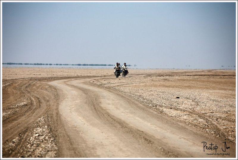 Locals riding bikes in Little Rann of Kutch