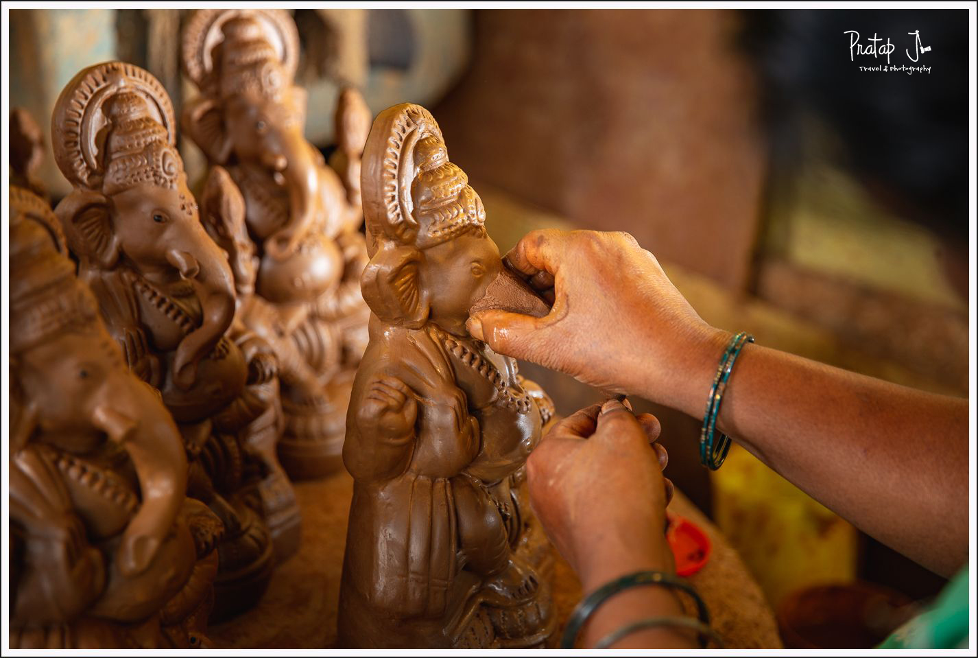 Attaching a trunk to a clay Ganesha