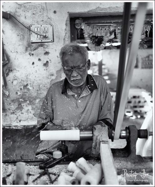 Artist making wooden toys