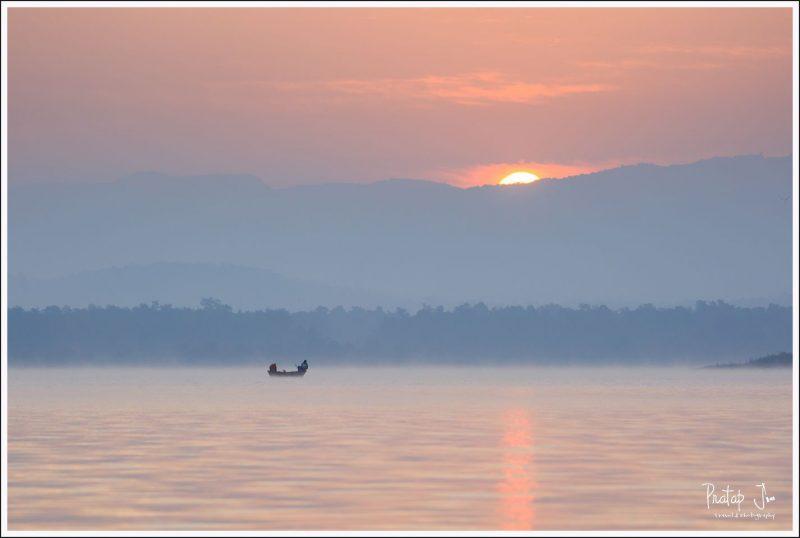 Two men fishing at sunrise