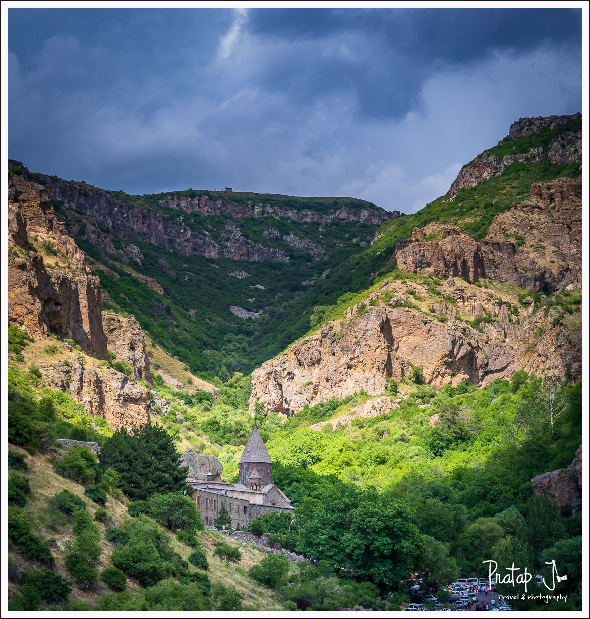 A view of geghard monastery in between mountains