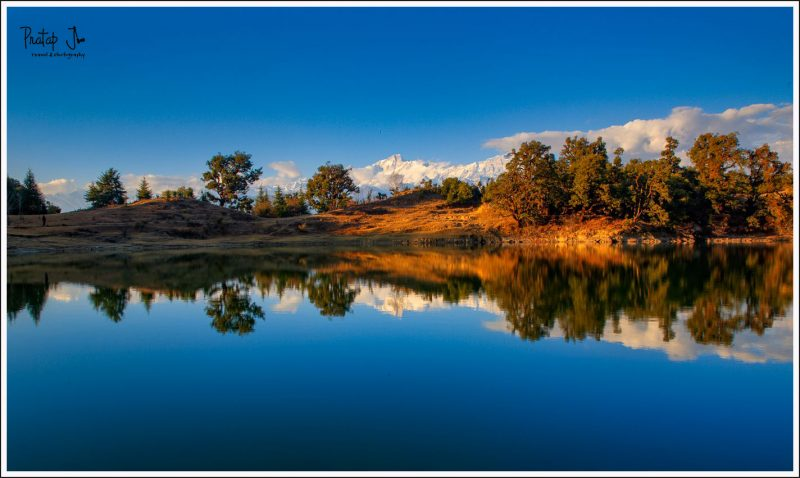 Still waters of Deoriatal with Kedarkantha Mountain Range