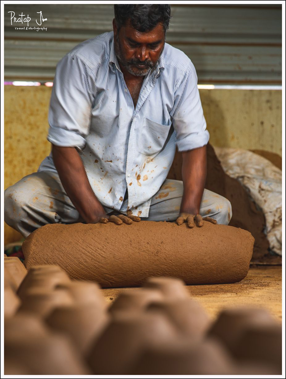 A potter kneading clay from the river bed