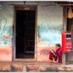 An old lady reads a prayer book in Gokarna