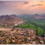 Sunrise over Achutharaya Temple in Hampi from Mathanga Hill