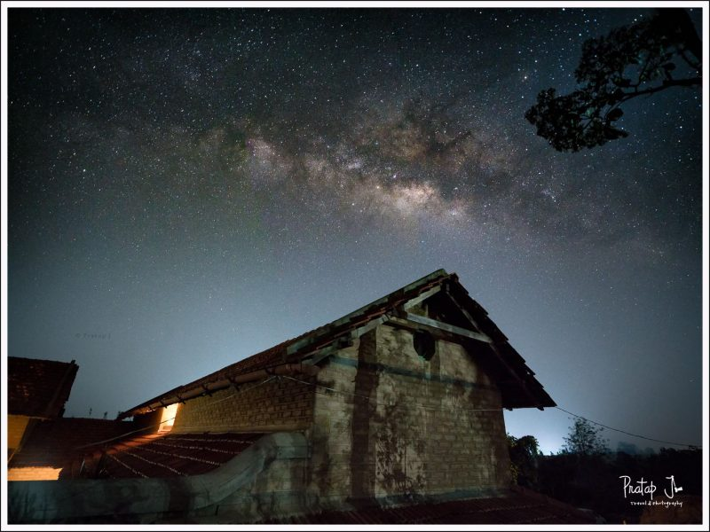Milky Way in the sky with a house in the foreground
