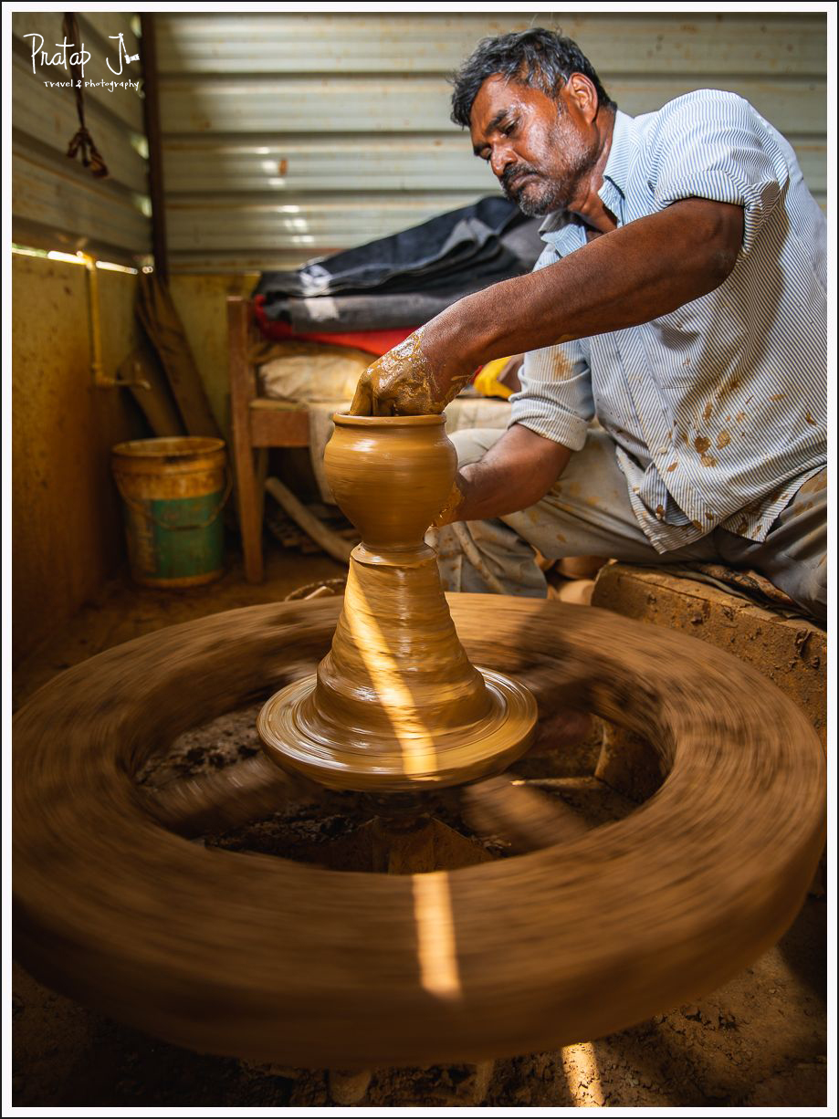 Portrait of a potter and his pottery wheel