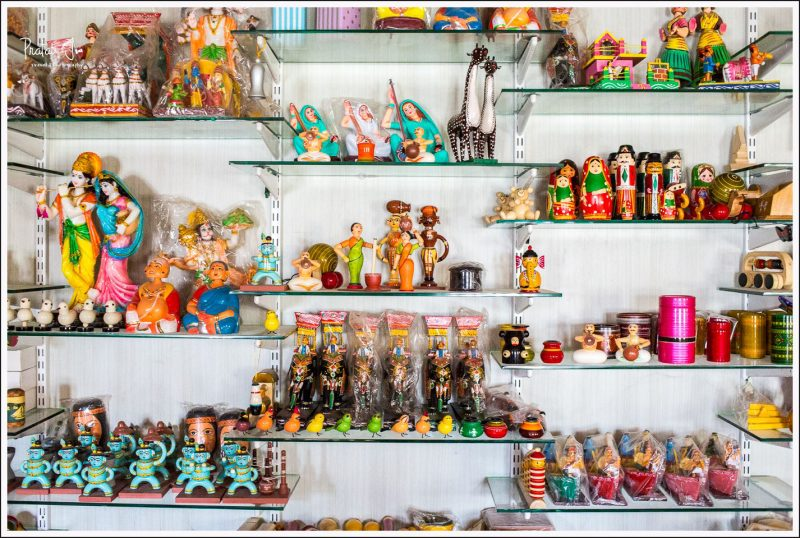 Shelf full of various wooden toys at Channapatna factory