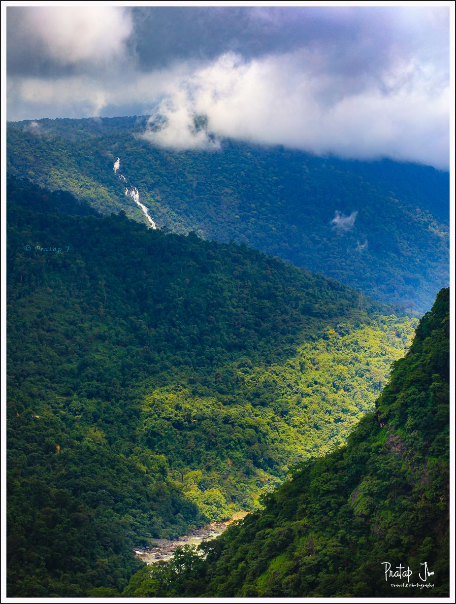 Play of light and shadow on the mountains near Jog falls