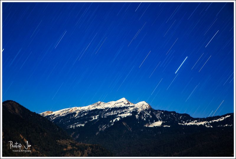 Chandrashila Peak and Star Trails over the Himalayas