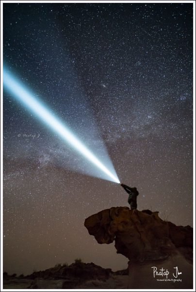 Man Holding a Light Sabre Against the Sky in Kutch